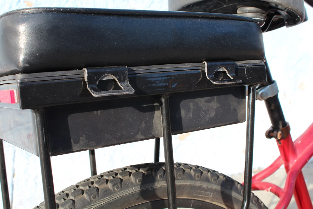 close-up of prototype companion bike seat pannier hooks