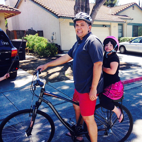 Father and daughter riding on Companion Bike Seat for the first time