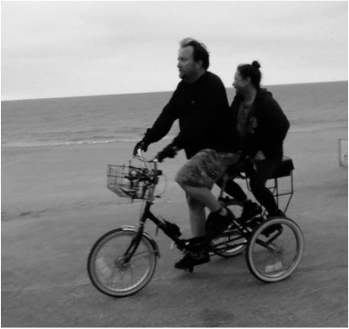 riding with companion bike seat on a tricycle on santa monica beach