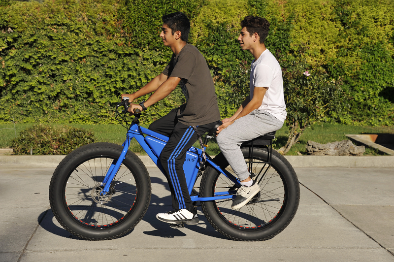 kids riding on a sondors ebike with a companion bike seat