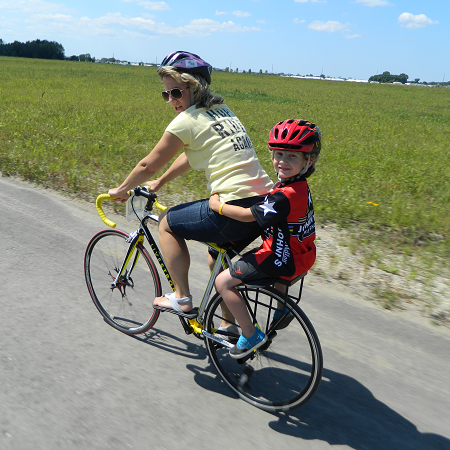 mother and son riding together on a Companion Bike Seat