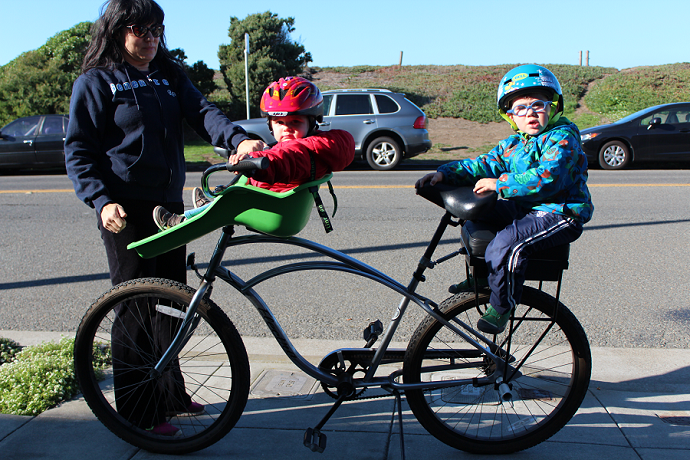 cruiser with a front-mounted bike child seat and a Companion Bike Seat