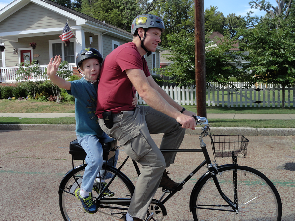 father and son riding with Companion Bike Seat